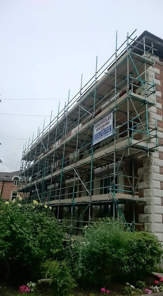 Scaffolding erected on the side of a building